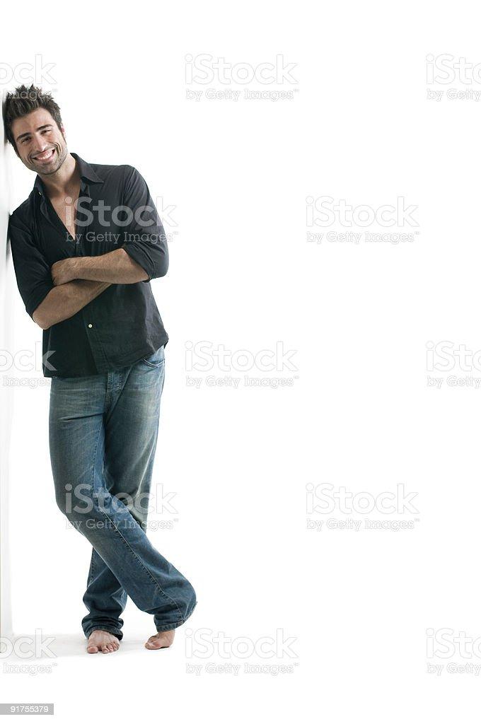 Latin man against white wall stock photo