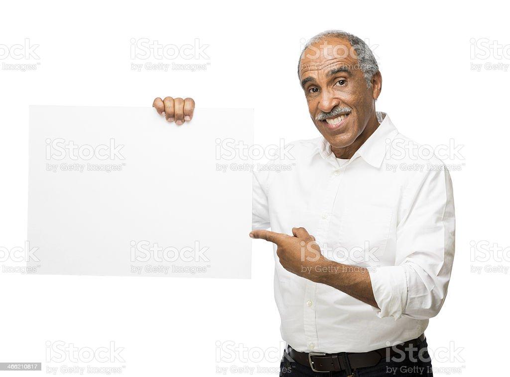 Latin man pointing to sign royalty-free stock photo