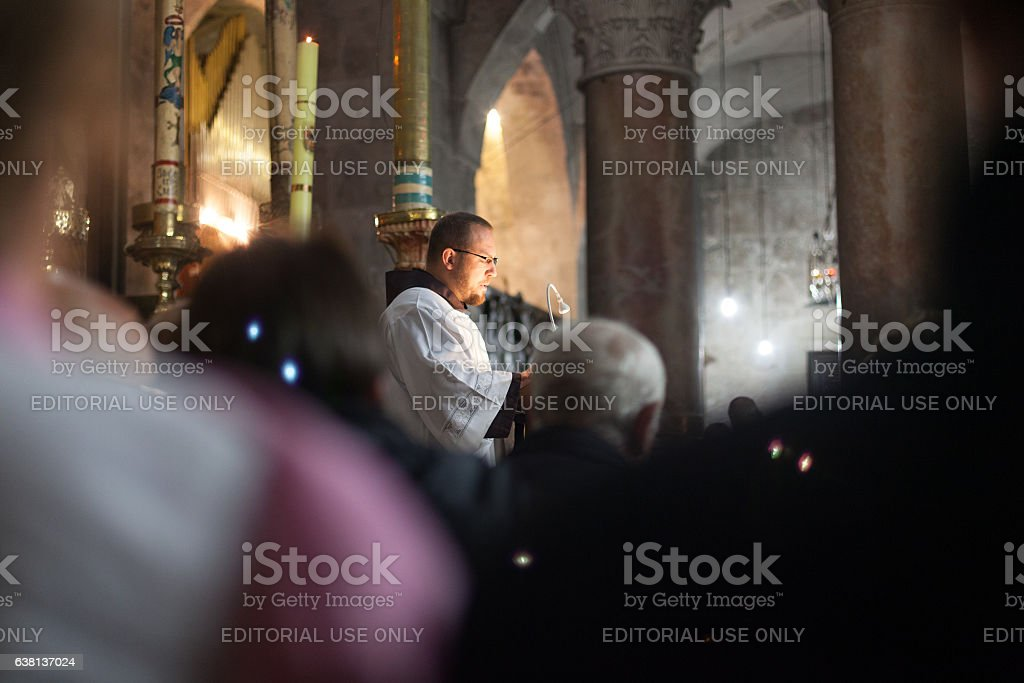Latin monk celebrates mass in Holy Sepulchre Church stock photo