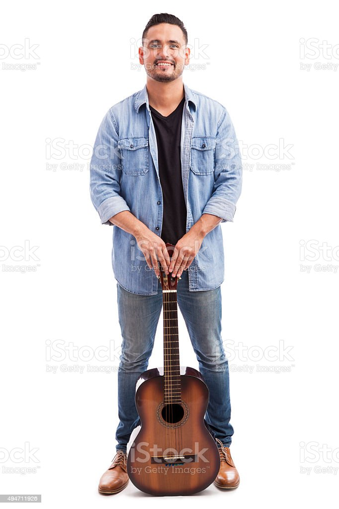 Latin musician with his guitar stock photo