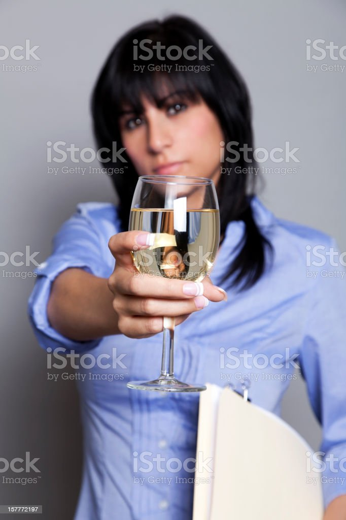 Latin office worker with a glass of wine. royalty-free stock photo