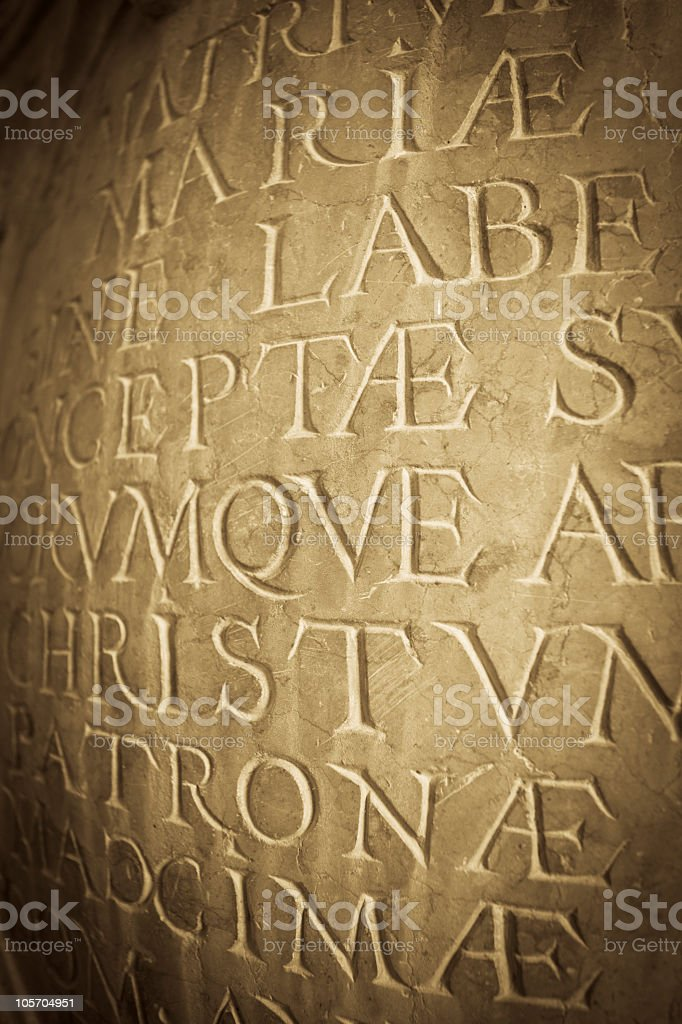 Latin script carved into rock, Italy stock photo