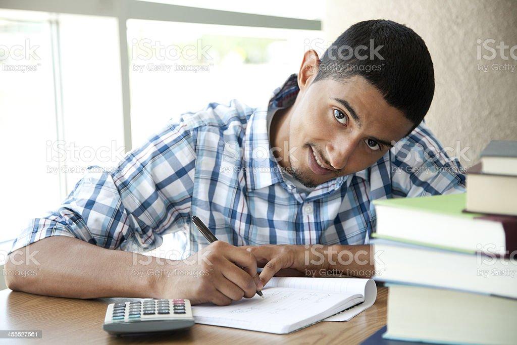 Latin student doing math royalty-free stock photo