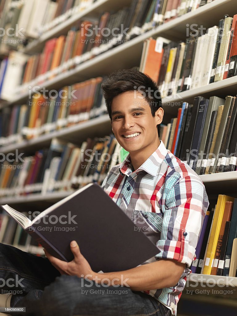 Latin student reading a book royalty-free stock photo