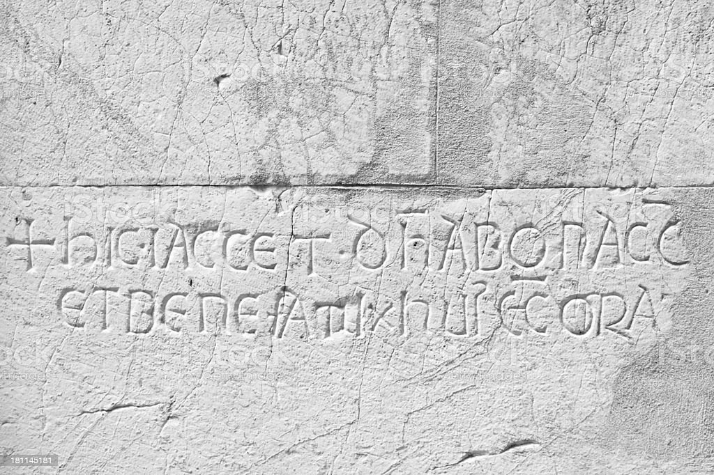 Latin text carved in stone stock photo