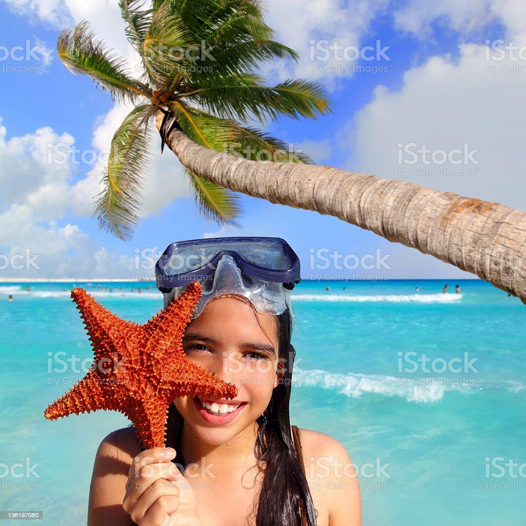 latin tourist girl holding starfish tropical beach royalty-free stock photo