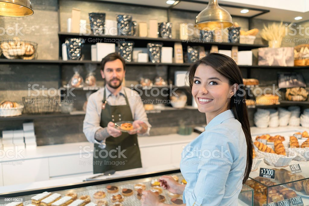 Latin woman at a bakery stock photo