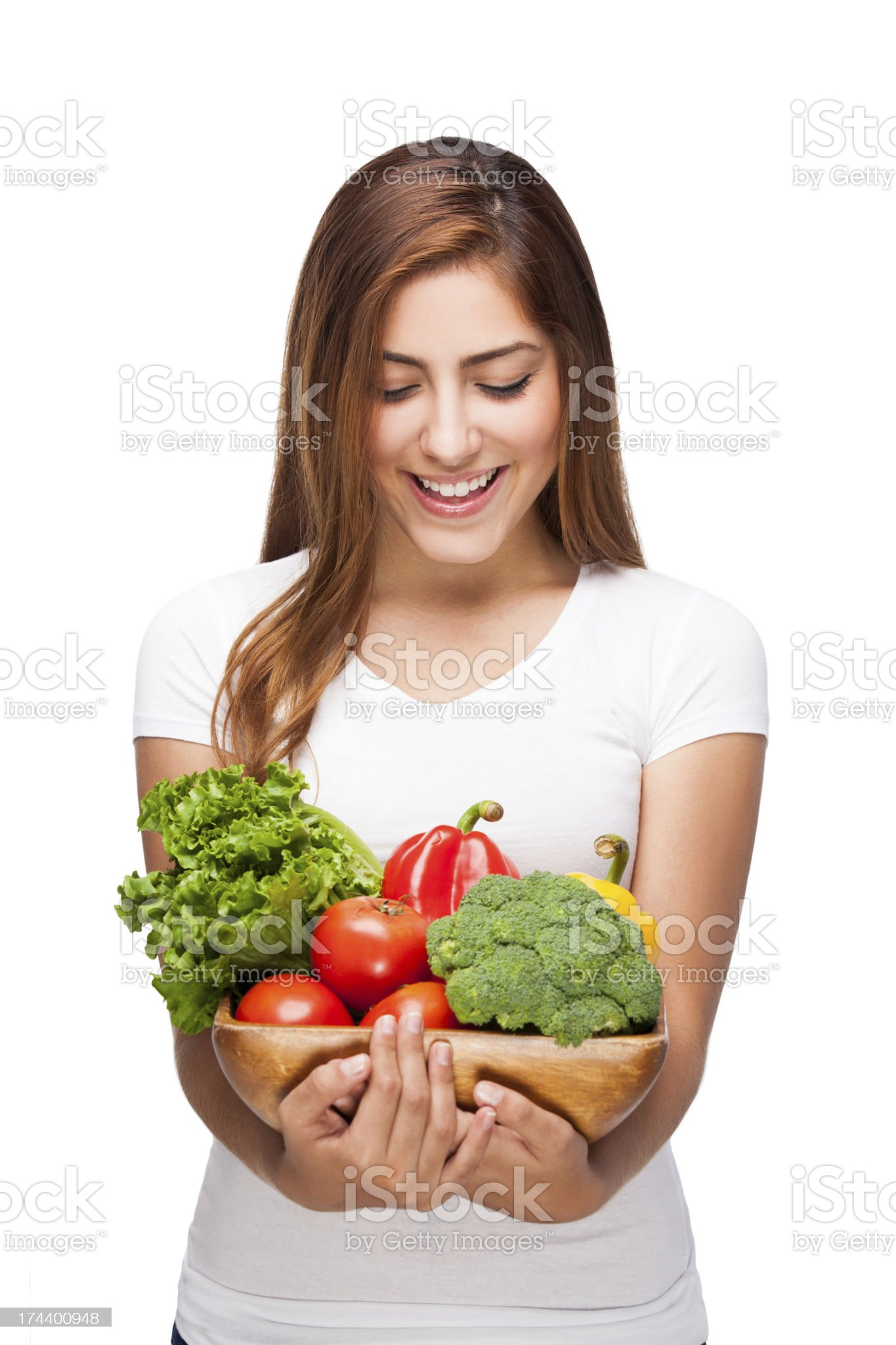 Latin woman holding some vegetables royalty-free stock photo