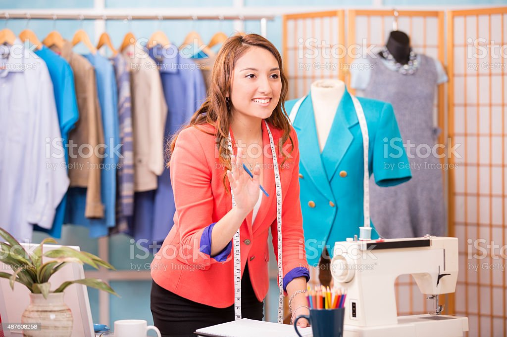 Latin woman, small business owner. Tailor, fashion designer, boutique. stock photo