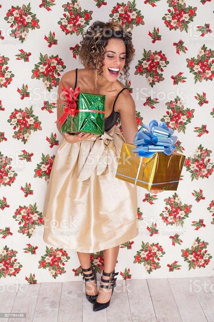 Latin woman with christmas gifts stock photo