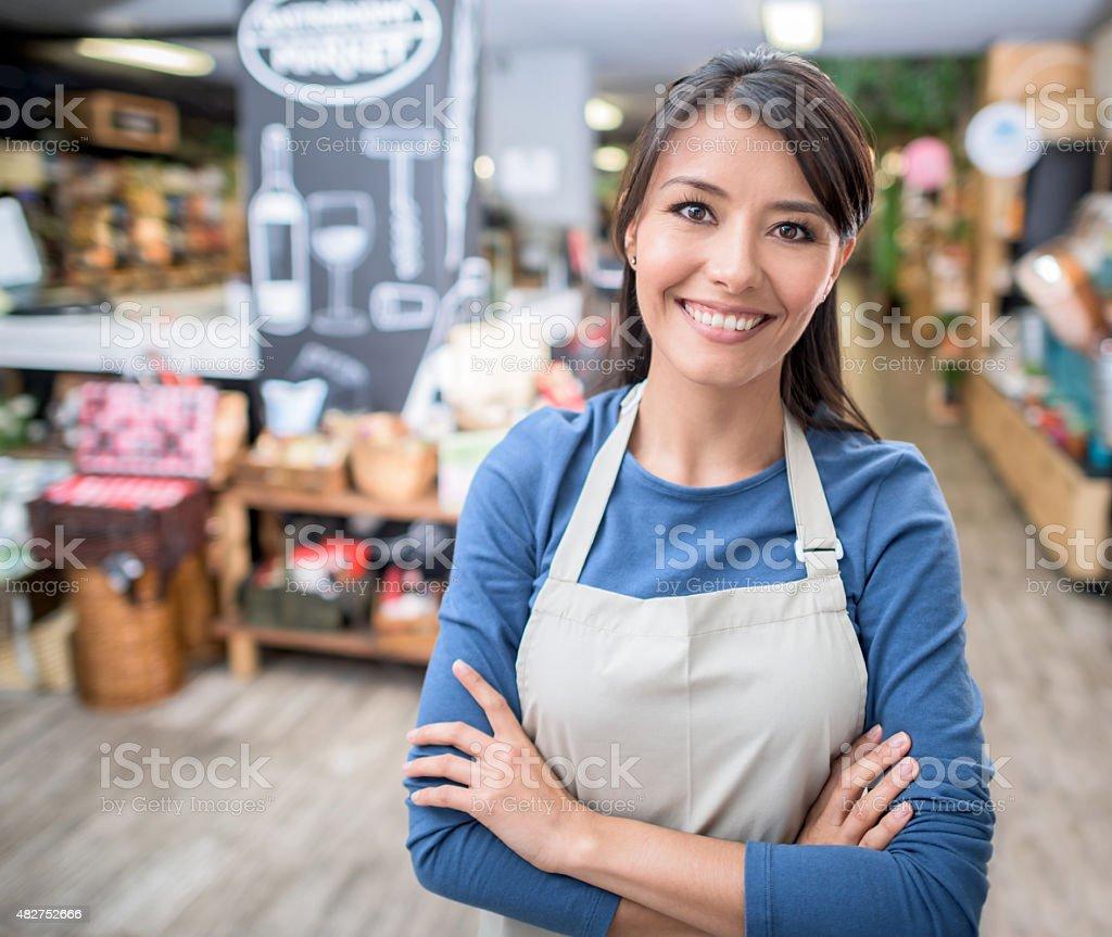 Latin woman working at a supermarket stock photo