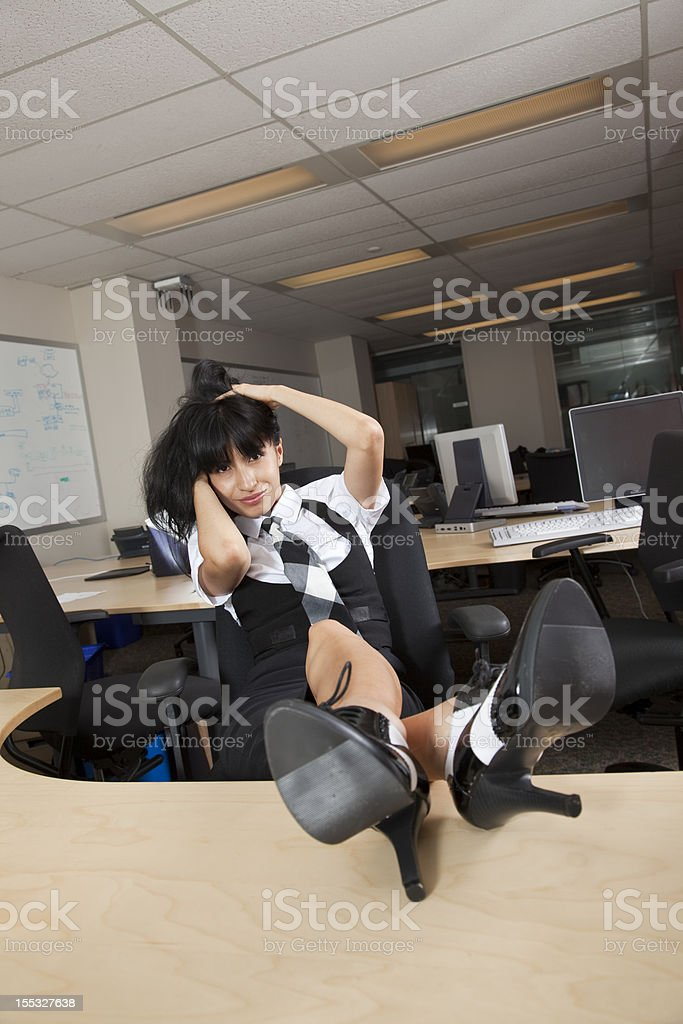 Latina businesswoman flirting stock photo