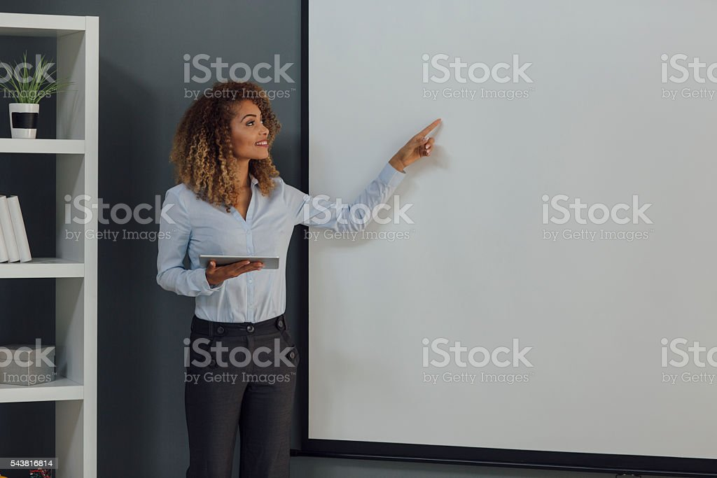 Latina Businesswoman Having Presentation In Her Office stock photo