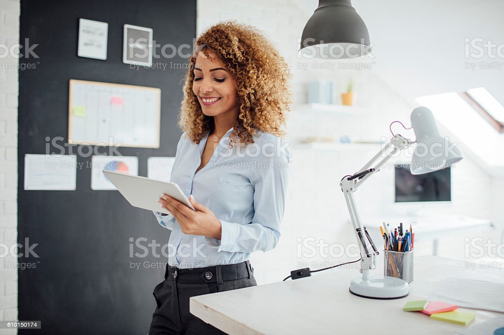 Latina Businesswoman Using Digital Tablet In Her Office stock photo