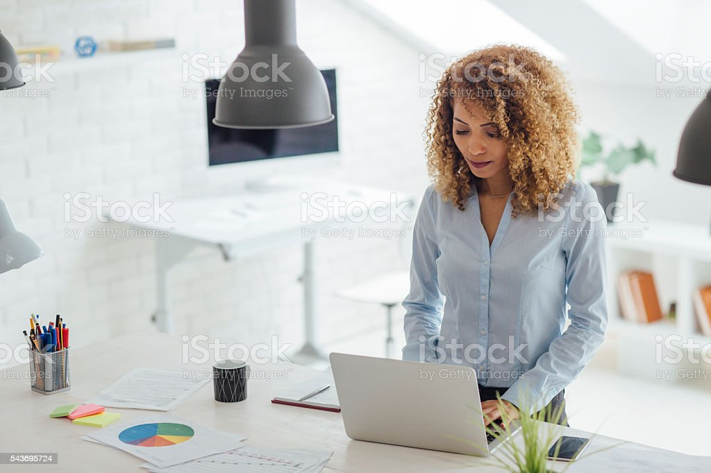 Latina Businesswoman Working In Her Office stock photo