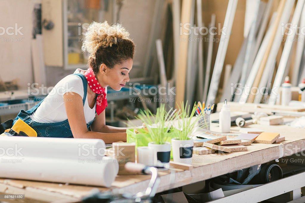 Latina Carpenter In Her Workshop stock photo