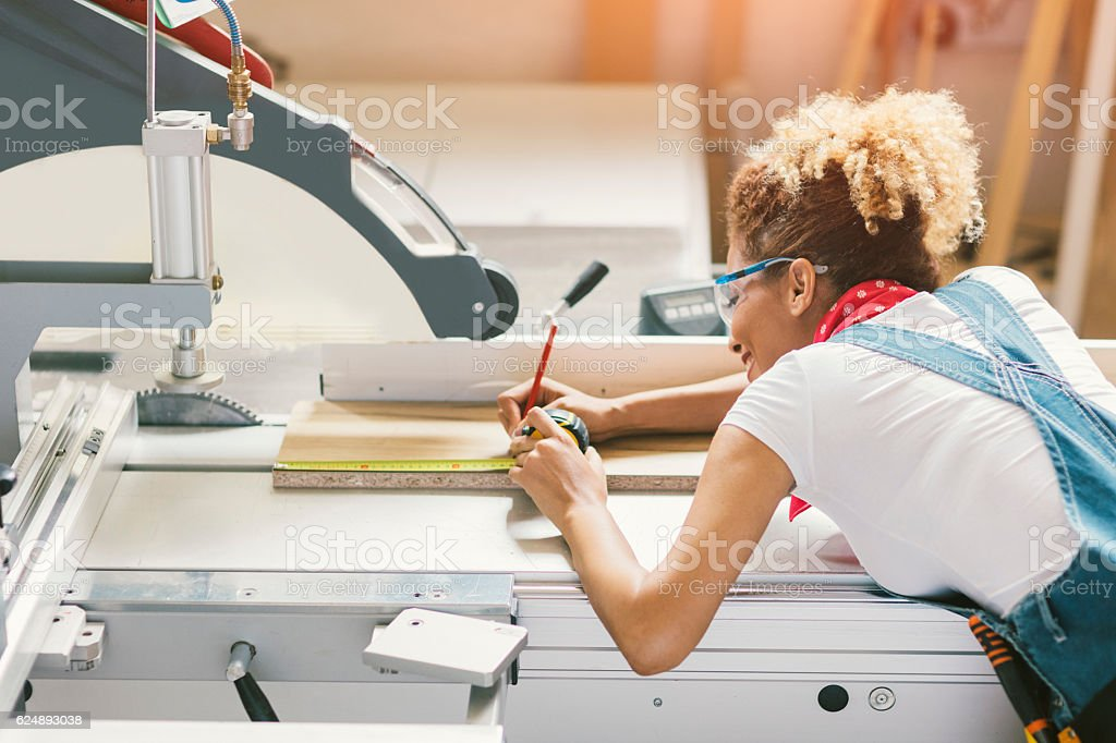 Latina Carpenter Working In Her Workshop stock photo