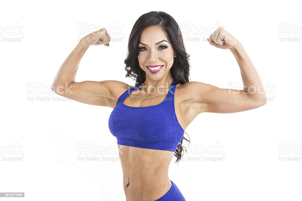 latina fitness model flexing biceps royalty-free stock photo