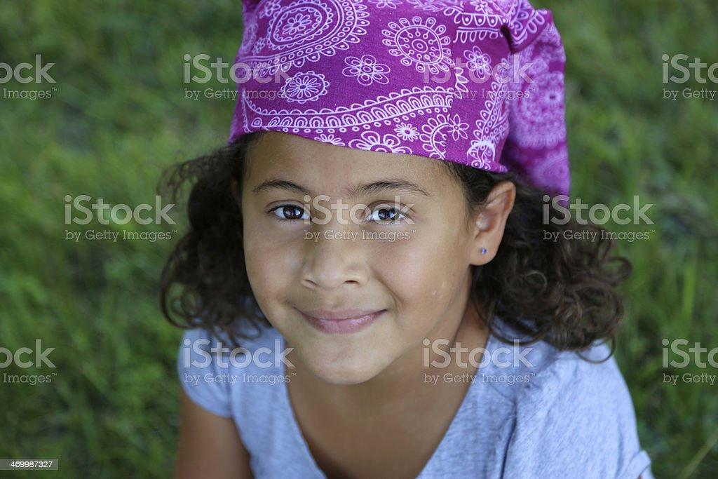 Latina girl with bandana head covering royalty-free stock photo