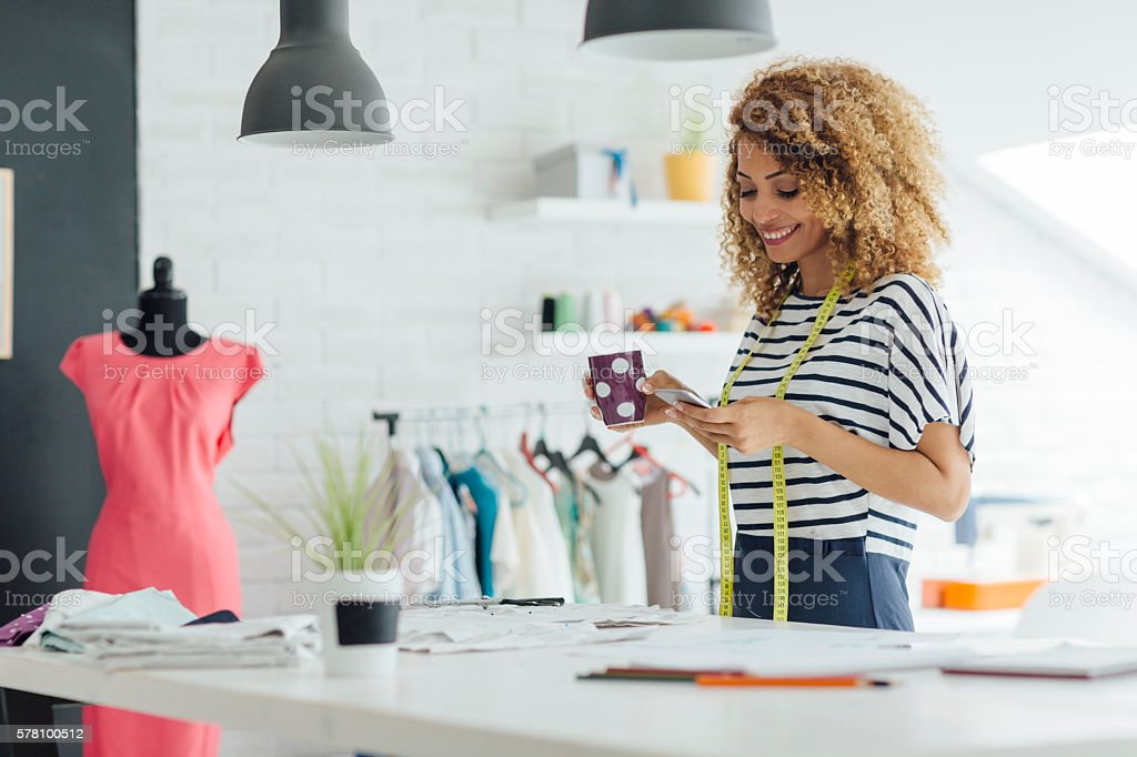 Latina Tailor In Her Workshop stock photo