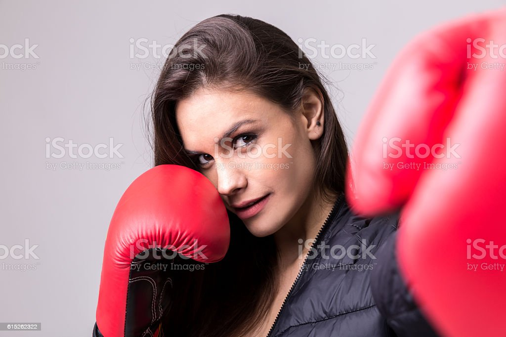 Latina young girl with boxing gloves stock photo