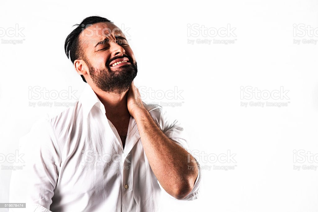 Latino Adult Male Feeling Emotional Stress or Physical Pain stock photo