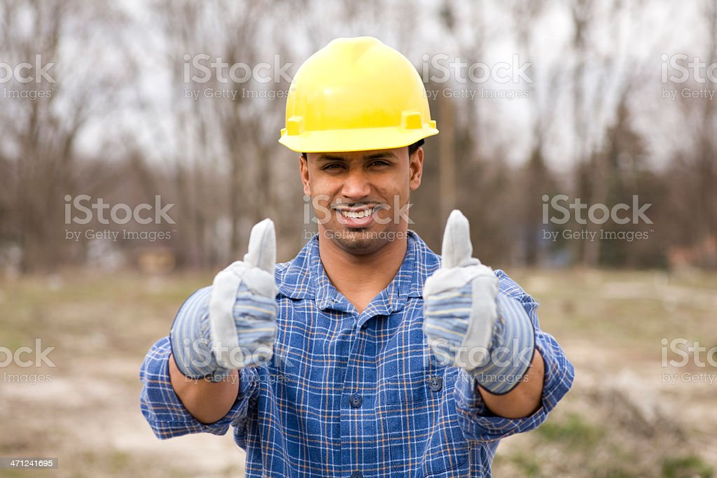 latino construction worker giving thumbs up royalty-free stock photo