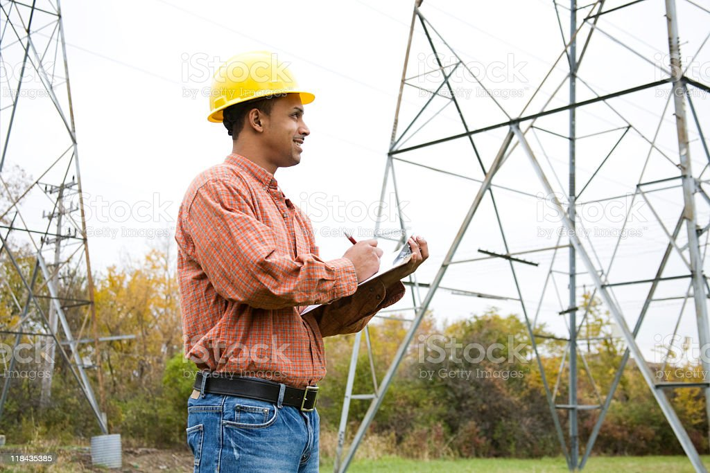 latino construction worker taking notes stock photo