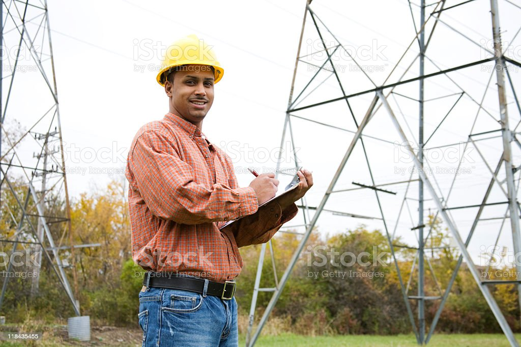 latino construction worker taking notes royalty-free stock photo