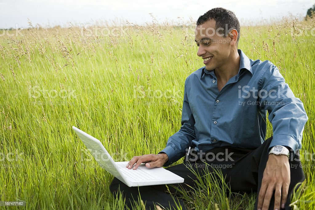 latino male on laptop royalty-free stock photo