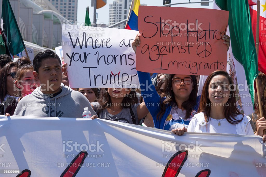 Latinos marching at anti-Trump protest stock photo