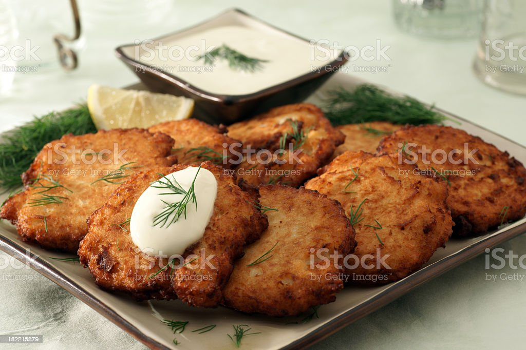 Latkes with garnishes and dressing stock photo