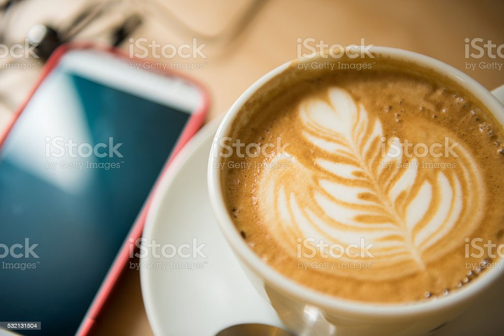 Latte and smart phone stock photo