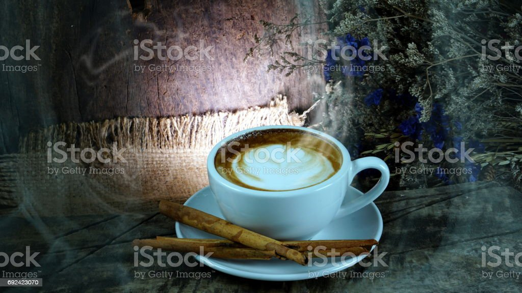 A cup of latte, cappuccino or espresso coffee with milk put on the...