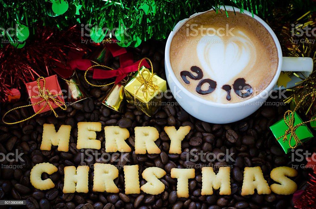 latte art coffee and alphabet 'merry christmas' stock photo