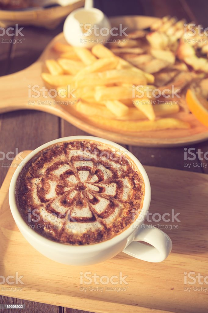 Latte Coffee art on the wooden desk vintage color stock photo