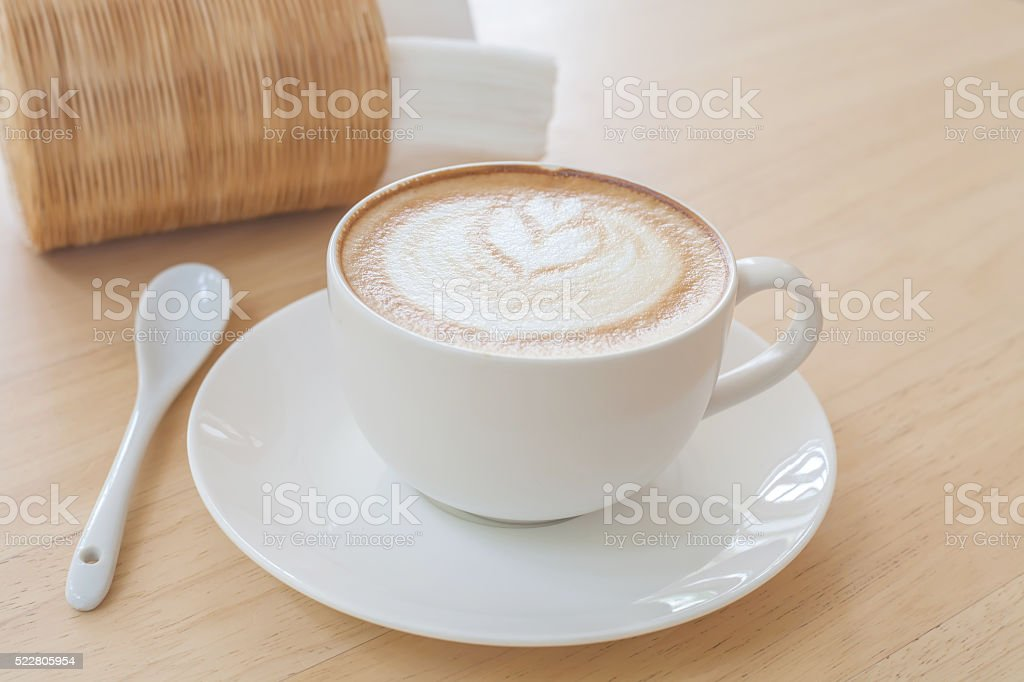 Latte Coffee art on the wooden table stock photo