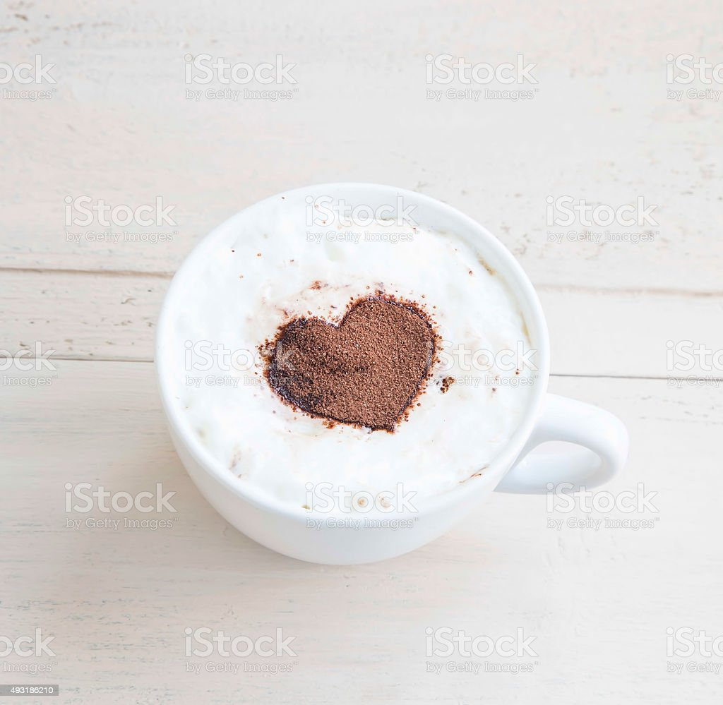 Latte Coffee Cup with Cocoa Heart Shape stock photo