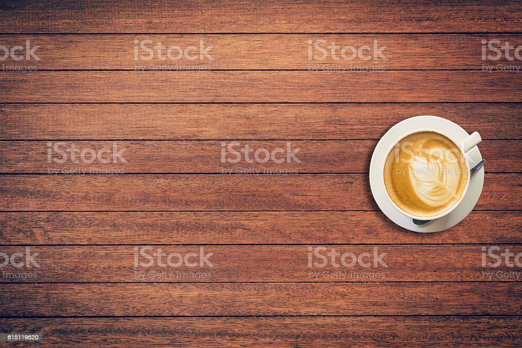 Latte coffee on table wood background with space stock photo