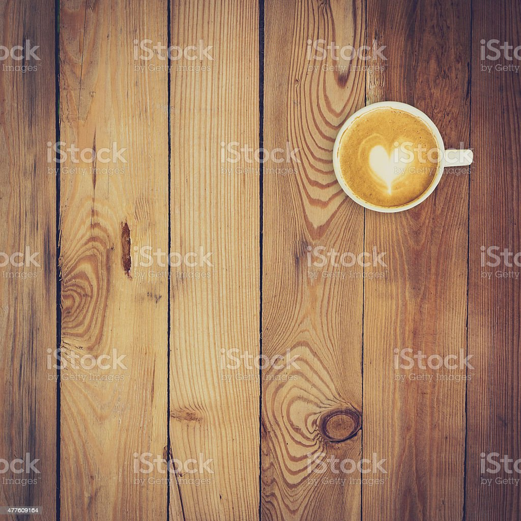 Latte coffee on wood background and texture with space stock photo