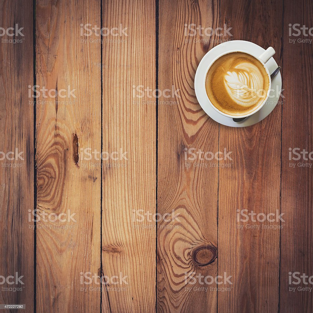 Latte coffee on wood with space stock photo