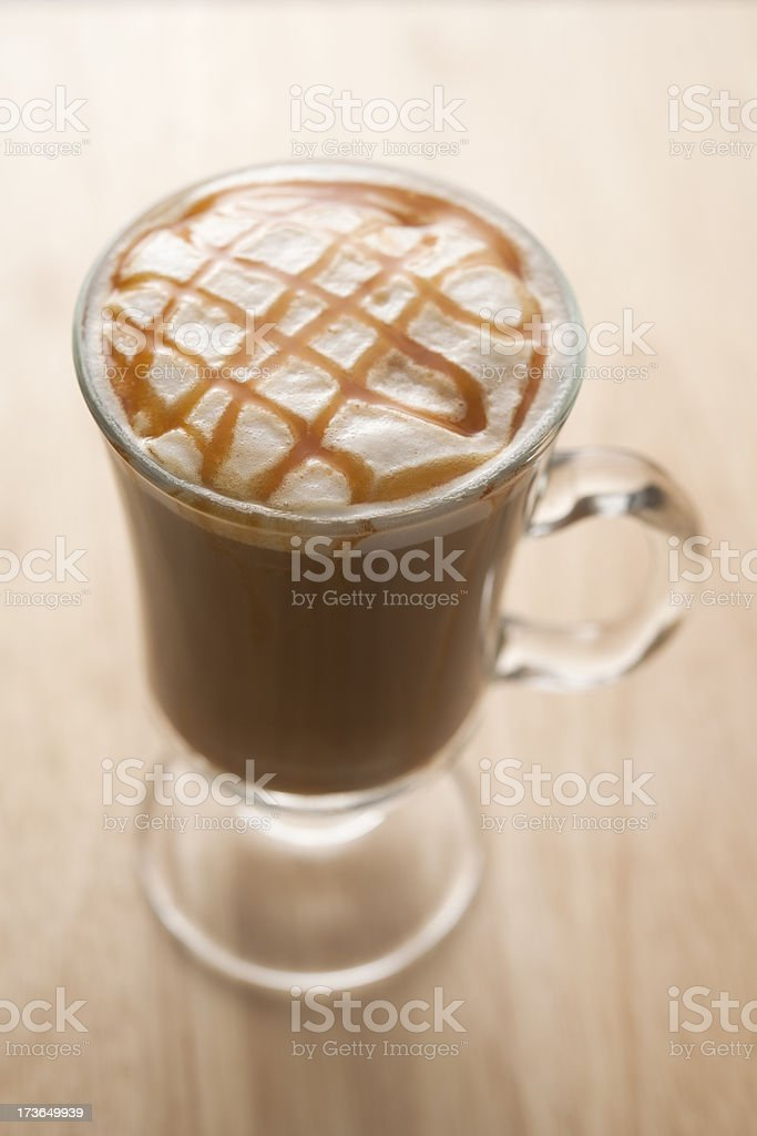 Latte coffee topped with Caramel syrup stock photo