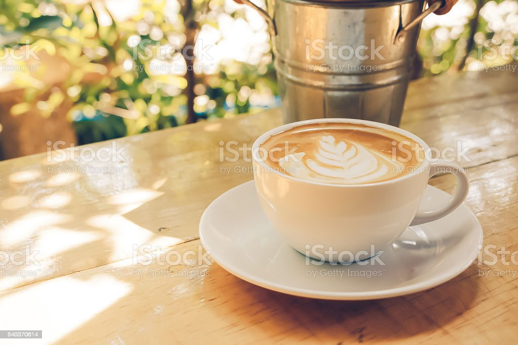Latte cup coffee on a table stock photo