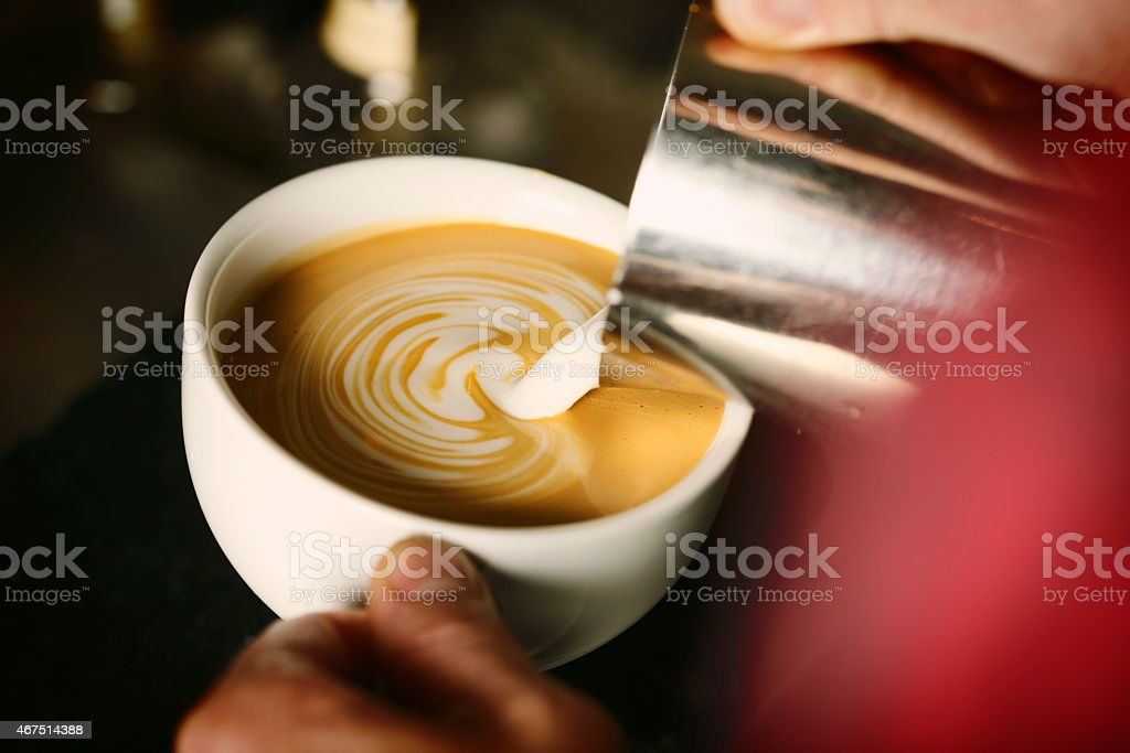 Latte Pour stock photo