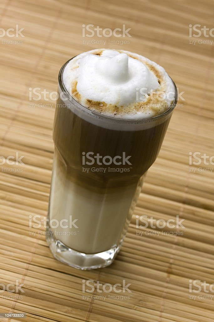 Latte Macchiato on the wooden Background royalty-free stock photo