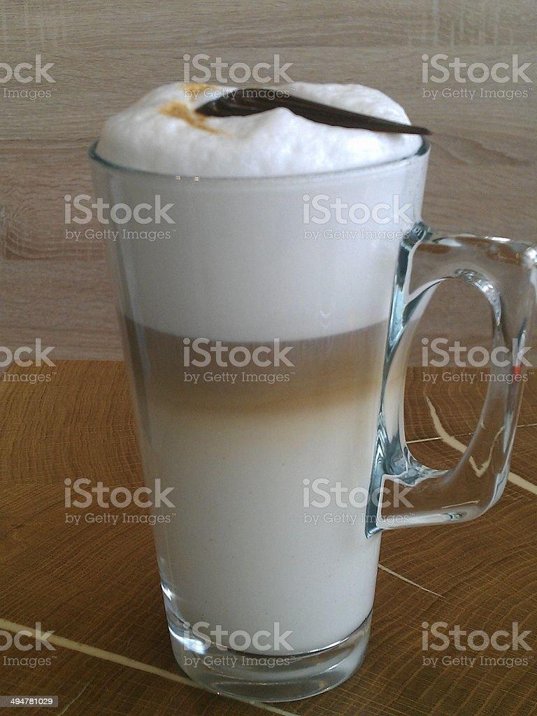 Latte macchiato on wooden background stock photo
