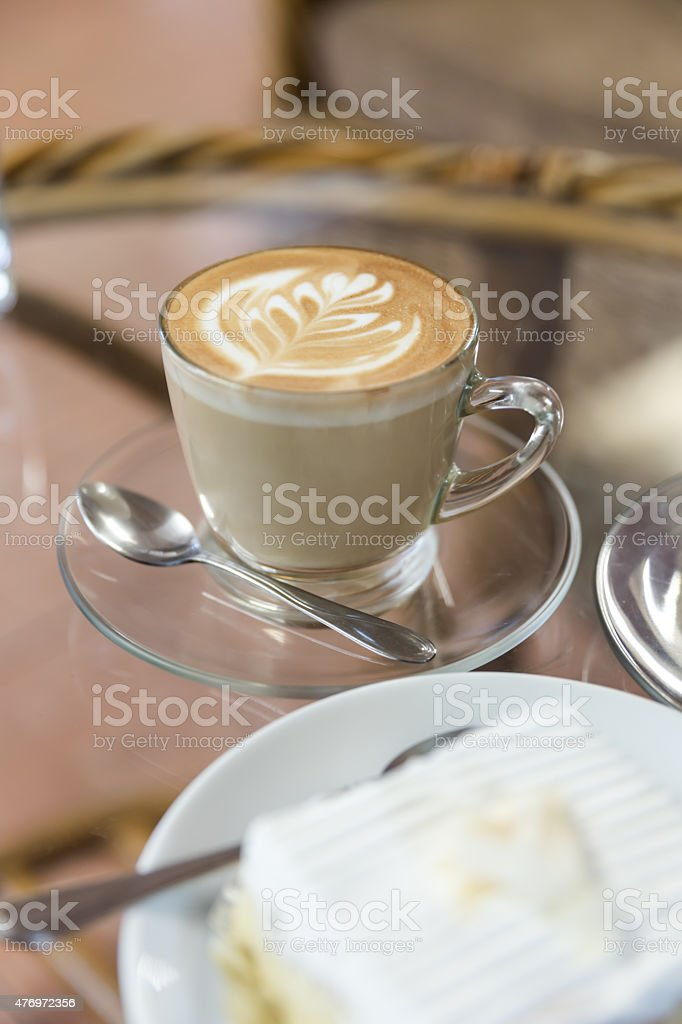 Latte or cappuccino coffee with coconut cake stock photo