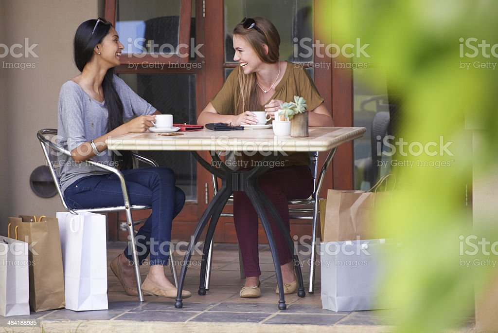 Lattes and laughter stock photo
