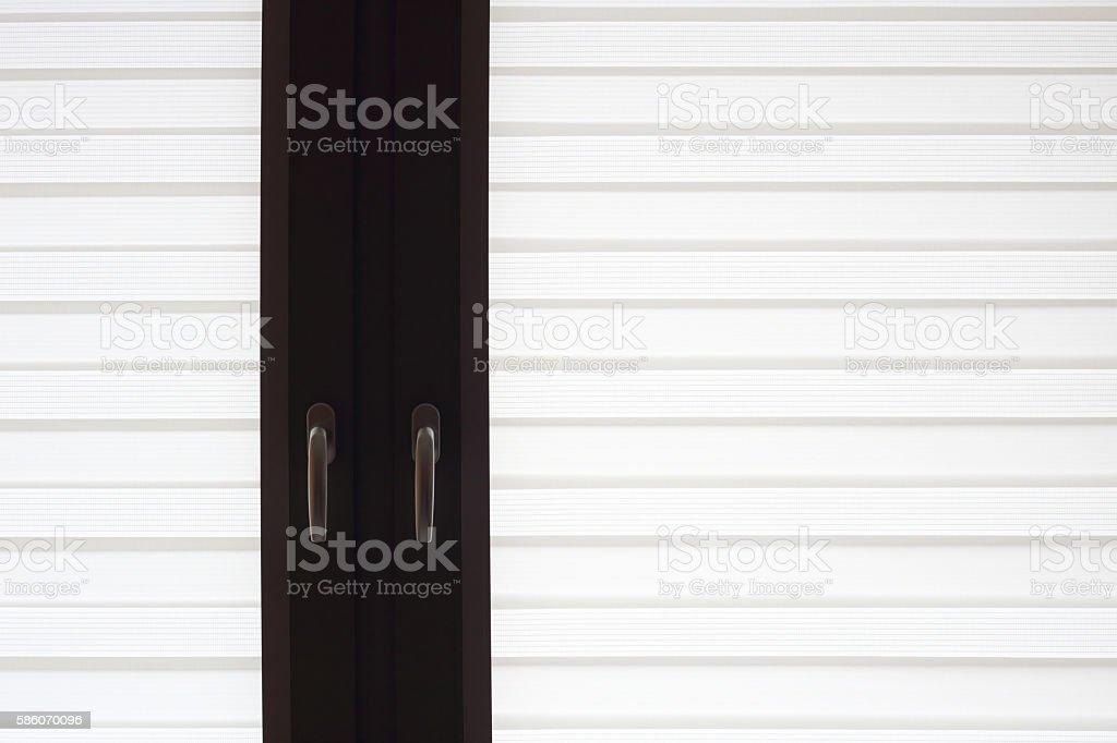 Latticed windows in dark wooden frames with chrome handles stock photo