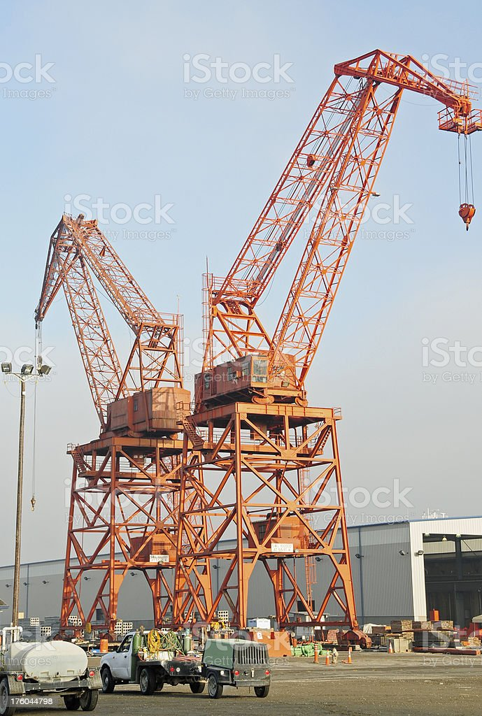 Latticework boom cranes at concrete plant stock photo